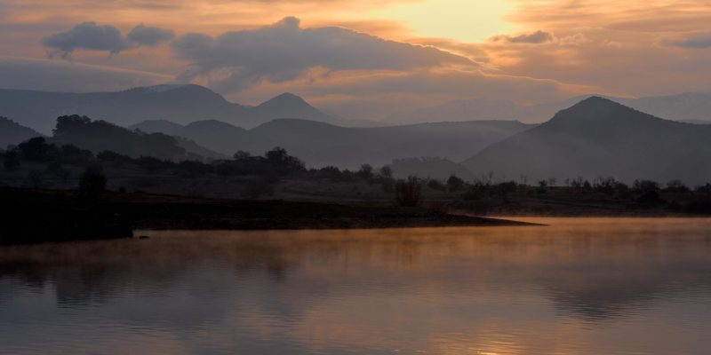 Misty sunrise over lake in Andalucia