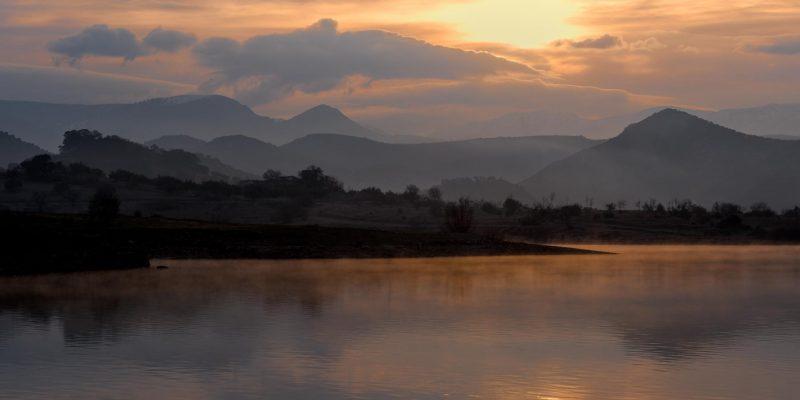 Misty sunrise over lake in Andalucia