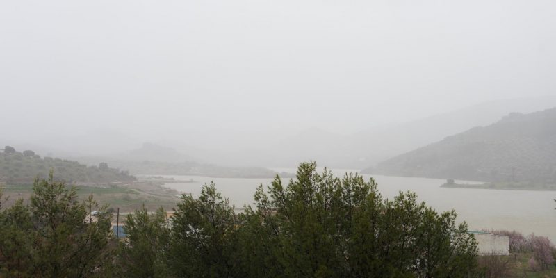 View of the lake in the rain
