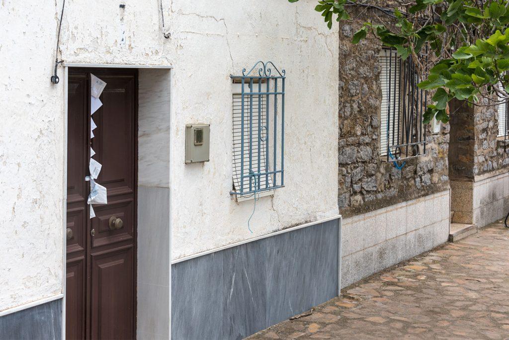 Letters wedged into gap in front door