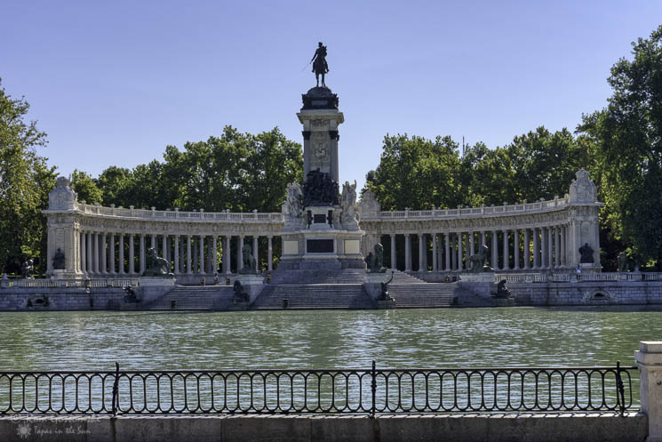 El Retiro park with the famous Alfonso XII monument and the boating lake.