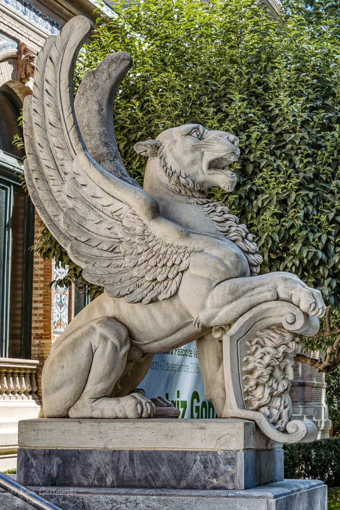One of the mythical winged lions at the entrance to the Palacio de Velázquez