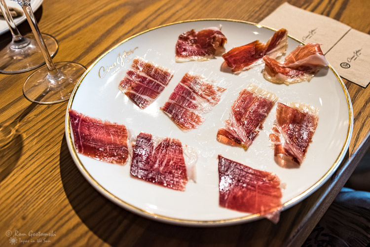 The tasting - three different cuts of Cinco Jotas Acorn-fed Ibérico Ham laid out on a plate.