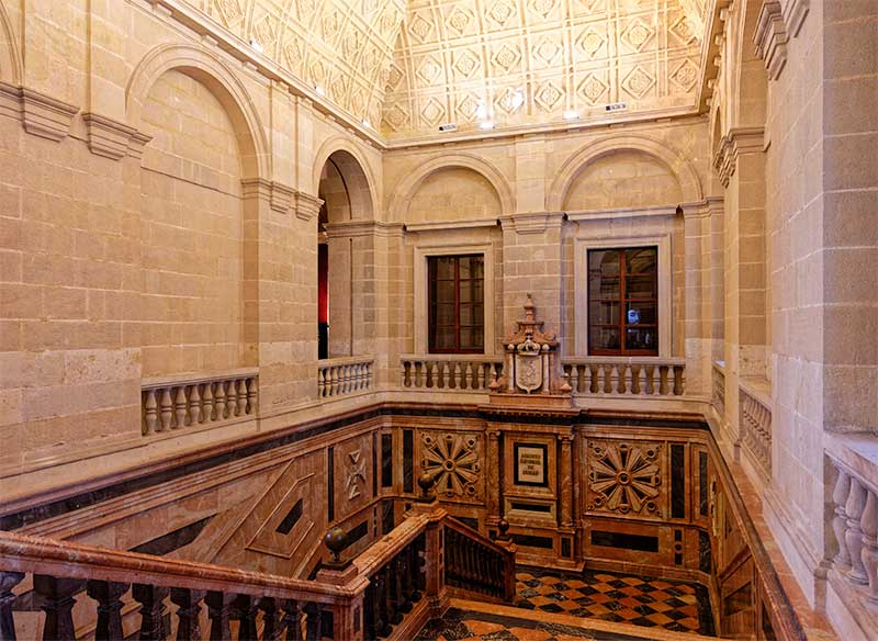 The spectacular marble main staircase in the Archivo de Indias