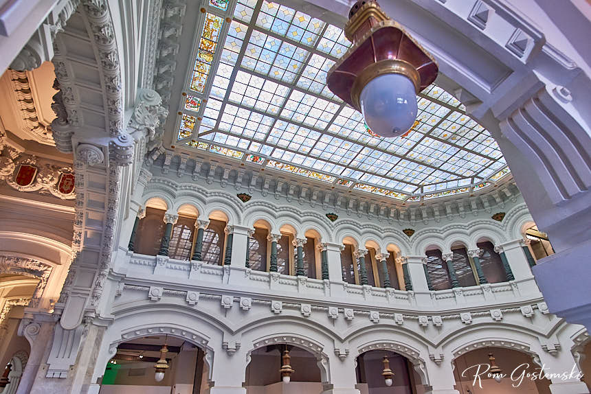 The ornate and lavish internal finishes in one of the atriums with stained glass roof