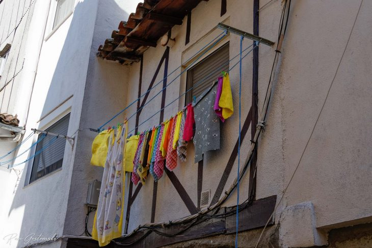 Laundry hung out to dry outside a window.