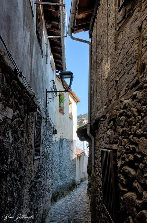 A narrow cobbled alley between the houses