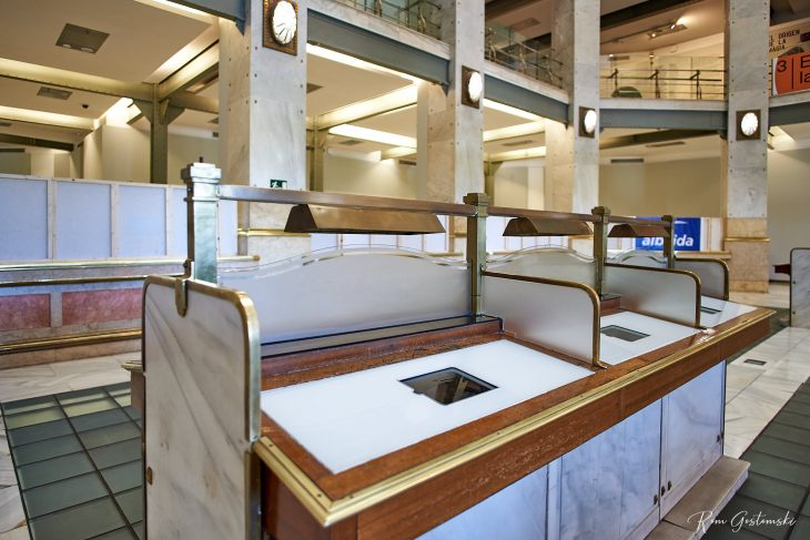 The marble desks where people would fill in forms. The original post office counters can be seen behind. Everything is big and spacious.
