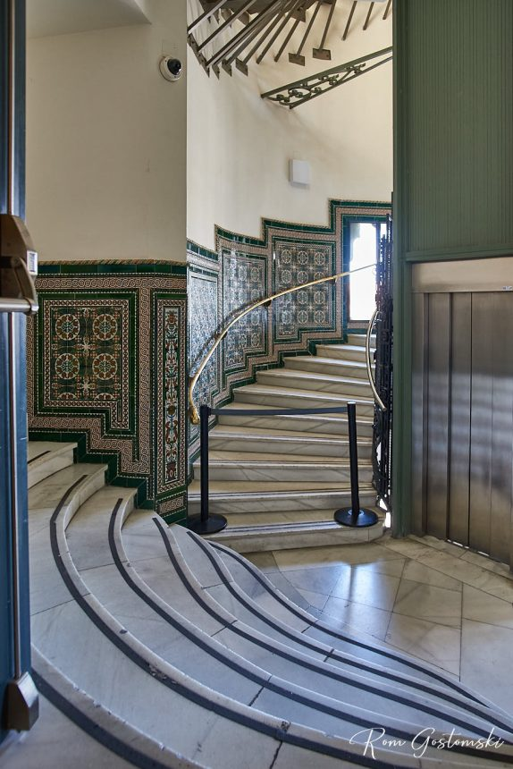 A small staircase tucked away at the back. Not in general use. Just look at the marble stairs and beautiful intricate wall tiles.