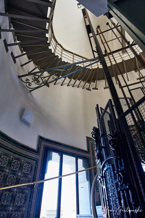 Looking up the metal cantilevered spiral staircase.